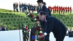 Prime Minister Justin Trudeau and French President Francois Hollande lay wreaths during a ceremony marking the 100th anniversary of the Battle of Vimy Ridge at the WWI Canadian National Vimy Memorial in Vimy, France, Sunday, April 9, 2017. The commemorative ceremony at the memorial honors Canadian soldiers who were killed or wounded during the Battle of Vimy Ridge in April 1917. (Philippe Huguen/Pool Photo via AP)