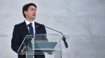 Prime Minister Justin Trudeau addresses the audience during a ceremony marking the 100th anniversary of the Battle of Vimy Ridge at the WWI Canadian National Vimy Memorial in Vimy, France, Sunday, April 9, 2017. The commemorative ceremony at the memorial honors Canadian soldiers who were killed or wounded during the Battle of Vimy Ridge in April 1917. (Philippe Huguen/Pool Photo via AP)