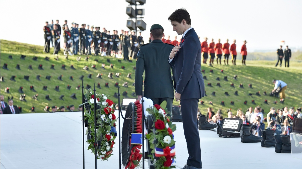 Canadian Prime Minister Justin Trudeau lays a wreath during a ceremony marking the 100th anniversary of the Battle of Vimy Ridge at the WWI Canadian National Vimy Memorial in Vimy, France, Sunday, April 9, 2017. (Philippe Huguen/Pool Photo via AP)