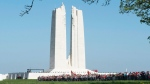 Spectators gather around the Canadian monument at Vimy Ridge, Sunday April 9, 2017 near Arras, France. THE CANADIAN PRESS/Adrian Wyld