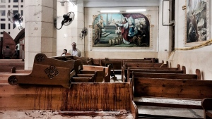 Blood stains pews inside the St. George Church after a suicide bombing, in the Nile Delta town of Tanta, Egypt, Sunday, April 9, 2017. (AP Photo/Nariman El-Mofty)