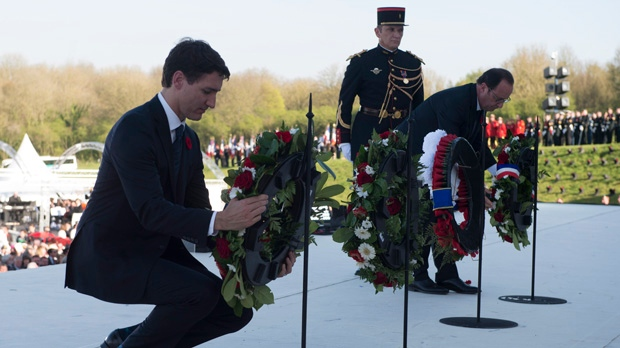 Canadian Prime Minister Justin Trudeau and French President Francois Hollande French place wreaths during a ceremony to mark the 100th anniversary of the Battle of Vimy Ridge, Sunday, April 9, 2017 near Arras, France. THE CANADIAN PRESS/Adrian Wyld