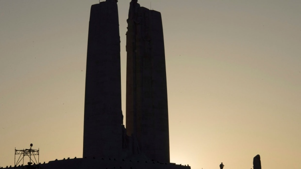 A person is silhouetted as they stand on the Vimy Ridge monument following a ceremony to mark the 100th anniversary of the battle, Sunday, April 9, 2017 near Arras, France. THE CANADIAN PRESS/Adrian Wyld