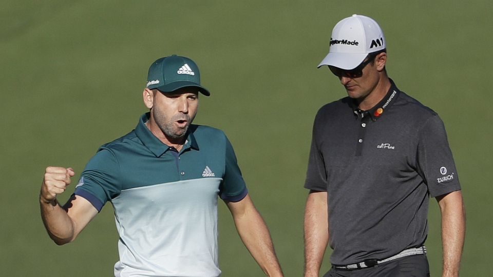 Sergio Garcia, of Spain, reacts in front of Justin Rose, of England, after making an eagle putt on the 15th hole during the final round of the Masters golf tournament in Augusta, Ga. Sunday, April 9, 2017. (AP / David Goldman)