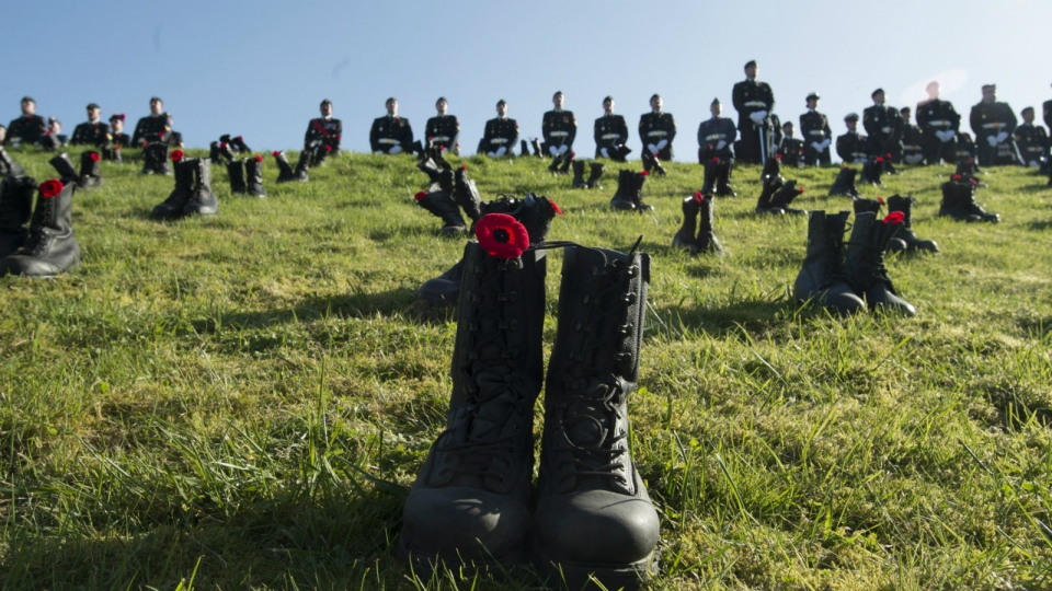 Canadian Forces soldiers parade at Vimy Ridge behind boots placed to honour the approximately 3,600 soldiers killed in the Battle of Vimy Ridge, near Arras, France Sunday, April 9, 2017. (Adrian Wyld / THE CANADIAN PRESS)
