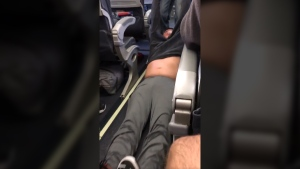 A passenger is shown being dragged from a United Airlines flight in Chicago on Apr. 9, 2017. (Twitter / Tyler Bridges)
