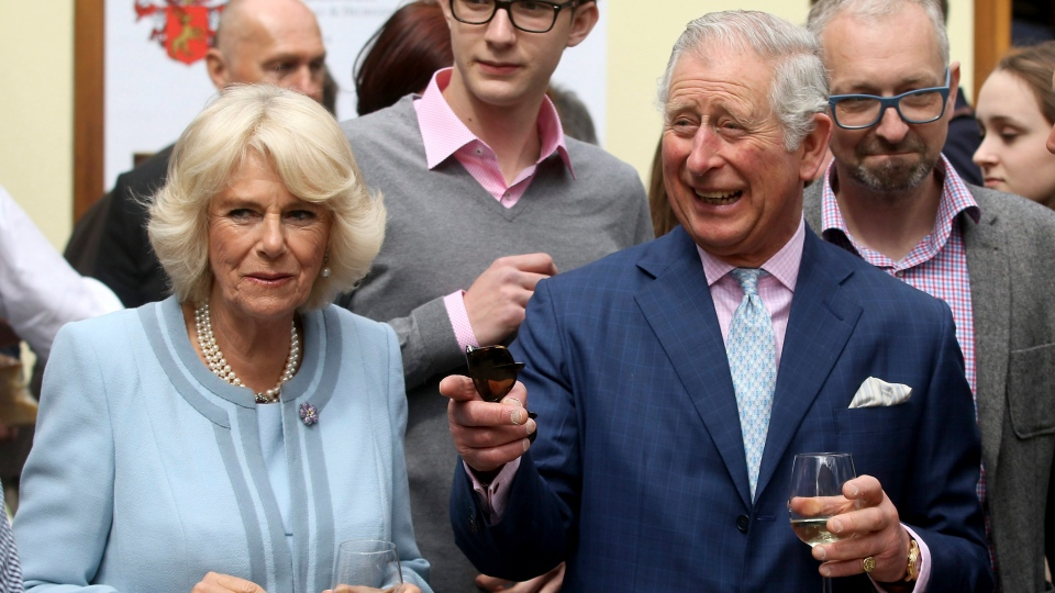 Camilla the Duchess of Cornwall and Prince Charles, from left, taste wine at a wine tavern in Vienna, Austria, Thursday, April 6, 2017. (Ronald Zak/AP)
