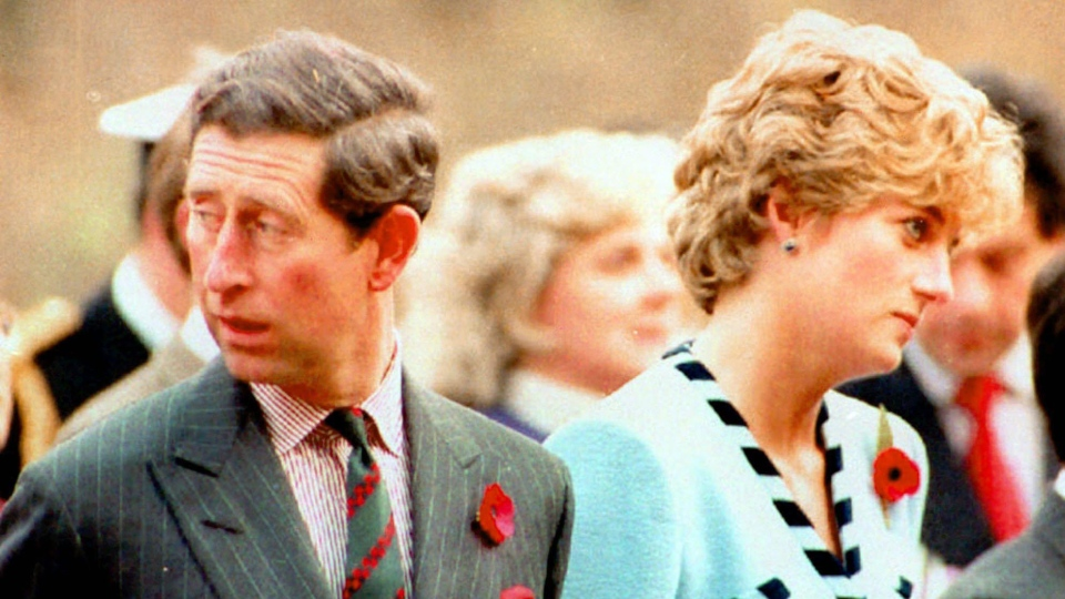 In this file photo taken on Wednesday, Dec. 20, 1992, Prince Charles and Princess Diana, look their separate ways, during a memorial service on their tour of South Korea. (AP Photo/File)