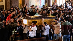 Men carry the coffin of a victim during the funeral for those killed in a Palm Sunday church attack in Alexandria, Egypt, at the Mar Amina church, Monday, April 10, 2017. (AP / Samer Abdallah)