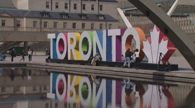 The Toronto sign at Nathan Phillips Square is shown.