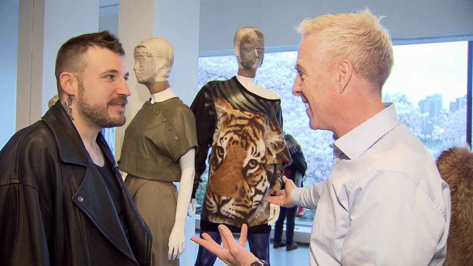 Fashion designer Evan Biddell shows Ross McLaughlin his collection made from pre-loved clothes from Value Village. (CTV)