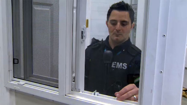 Adam Loria with Calgary EMS demonstrates how to install window clips to limit how much it opens.