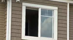 Paramedics say you can install devices to limit how far a window can open in your home, but the best way is to make sure children aren't able to access them. (File)