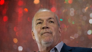 NDP Leader John Horgan addresses supporters during an election campaign kickoff rally in Surrey, B.C., on Sunday April 9, 2017. (Darryl Dyck/The Canadian Press)