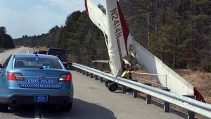 In this photo released by Maine State Police, a plane stands on its nose after striking a guardrail after it landed Tuesday, April 11, 2017, in the southbound lane of Interstate 295 in Bowdoinham, Maine. (Maine State Police via AP)