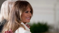 This is a Wednesday, March 29, 2017, file photo of U.S. first lady Melania Trump smiles as she is recognized by President Donald Trump as he speaks at a women's empowerment panel, in the East Room of the White House in Washington. (AP Photo/Andrew Harnik, File)