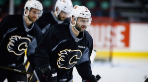 Calgary Flames' Mark Giordano, right, skates during a team practice in Calgary, Monday, April 10, 2017. The Flames will play the Anaheim Ducks in the first round of the NHL playoffs (THE CANADIAN PRESS/Jeff McIntosh).