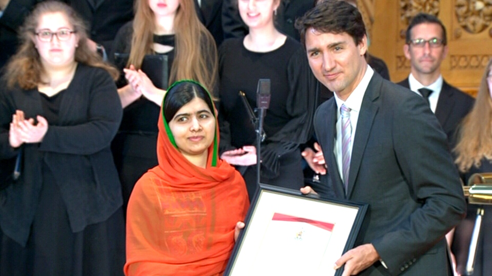 Prime Minister Justin Trudeau presents Malala Yousafzai with an Honourary Canadian Citizenship as she visits Parliament Hill, in Ottawa, Wednesday, April 12, 2017.