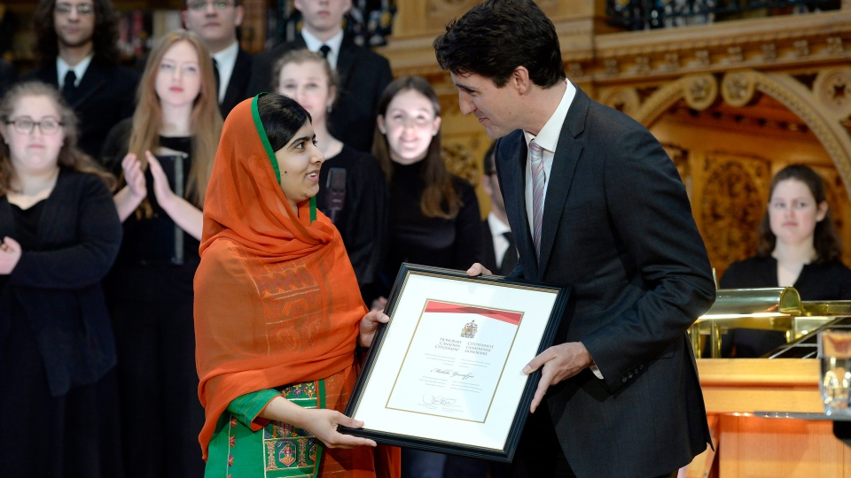 Pakistani activist and Nobel Peace Prize winner Malala Yousafzai, left, is presented with an honorary Canadian citizenship by Prime Minister Justin Trudeau in on Parliament Hill in Ottawa on Wednesday, April 12, 2017. (Adrian Wyld / THE CANADIAN PRESS)