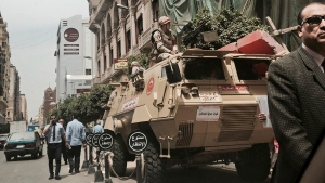 FILE -- In this Monday, April 10, 2017 file photo, soldiers guard a street near a church in downtown Cairo, Egypt. (AP Photo/Nariman El-Mofty)