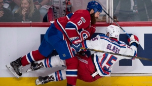 Jordie Benn demonstrates the grit that made him a Canadien as he flattens Tanner Glass during the first period of the first playoff game on April 12, 2017. (The Canadian Press/Ryan Remiorz)