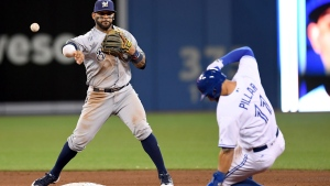 Toronto Blue Jays centre fielder Kevin Pillar (11) slides out at second base as Milwaukee Brewers' Jonathan Villar throws to first during eighth inning,  in Toronto, on Wednesday, April 12, 2017. (THE CANADIAN PRESS/Frank Gunn)