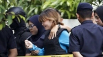Vietnamese suspect Doan Thi Huong, centre, arrested in the death of Kim Jong Nam, is escorted by police officers as she leaves a court house in Sepang, Malaysia on Thursday, April 13, 2017. (AP / Vincent Thian)