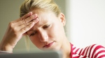 A woman appears stressed in this stock image. (diego_cervo / Istock.com)