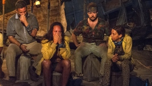 In this image released by CBS, contestants, from left, Jeff Varner, Sarah Lacina, Zeke Smith and Debbie Wanner appear at the Tribal Council portion of the competition series 'Survivor: Game Changers.' (Jeffrey Neira / CBS)