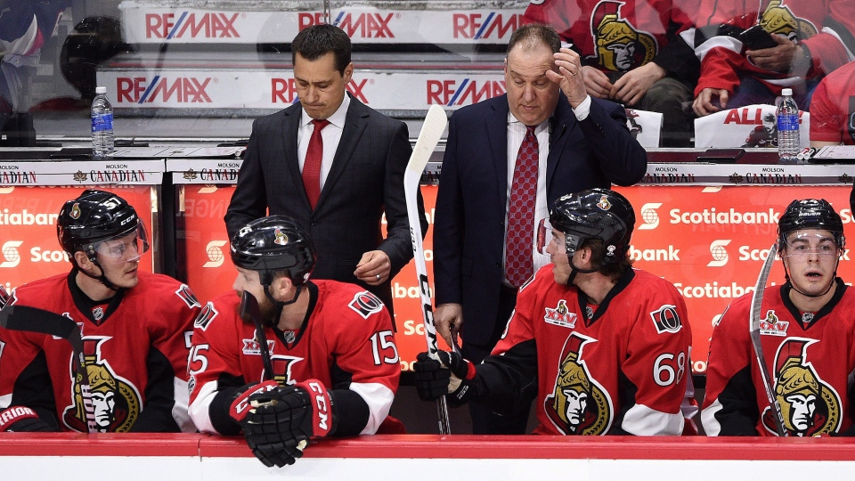 Ottawa Senators head coach Guy Boucher, left, and assistant coach Martin Raymond react to a penalty during the first period the first round of Stanley Cup playoff action against the Boston Bruins, in Ottawa on Wednesday, April 12, 2017. (Sean Kilpatrick/THE CANADIAN PRESS)