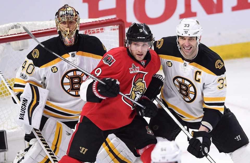 Boston Bruins goalie Tuukka Rask, left, and Zdeno Chara defend against Ottawa Senators' Bobby Ryan during second period of game one NHL Stanley Cup hockey playoff action in Ottawa, Wednesday, April 12, 2017. (Sean Kilpatrick/THE CANADIAN PRESS)