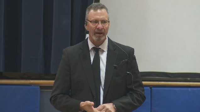 Former NHL goalie Clint Malarchuk, who survived both a slashed throat and a later suicide attempt, spoke to Kuper Academy students about the stigma surrounding mental health.