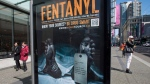 An anti-fentanyl advertisement funded by the Vancouver Police Foundation is seen on a sidewalk, on Tuesday, April, 11, 2017. (THE CANADIAN PRESS/Jonathan Hayward)