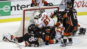 Anaheim Ducks players are tangled up with Calgary Flames players during the third period in Game 1 of a first-round NHL hockey Stanley Cup playoff series in Anaheim, Calif. on Thursday, April 13, 2017. (AP / Jae C. Hong)