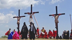 Filipino penitents on wooden crosses take part in a reenactment during Good Friday rituals at Cutud, Pampanga province, northern Philippines on Friday, April 14, 2017. (AP / Vicente Gonzales)