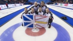 Canada skip Brad Gushue celebrates his gold medal win over Sweden with third, Mark Nichols, second, Brett Gallant, lead, Geoff Walker, alternate, Tom Sallows and coach, Jules Owchar at the Men's World Curling Championships in Edmonton, Sunday, April 9, 2017. THE CANADIAN PRESS/Jonathan Hayward