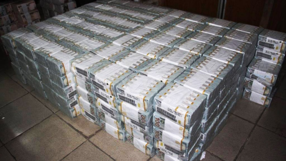 The money was found neatly wrapped in fireproof cabinets. (Economic and Financial Crimes Commission)