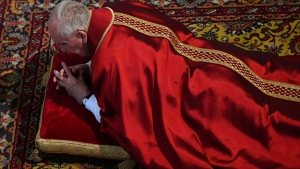 Pope Francis lies down in prayer during the Good Friday Passion of Christ Mass inside St. Peter's Basilica, at the Vatican, Friday, April 14, 2017.(Alberto Pizzoli/Pool Photo via AP)