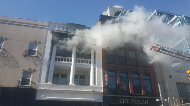 Smoke was seen billowing from 37 King Street West. (Courtesy: Nic Murray/Twitter)