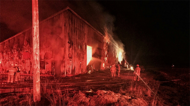 Firefighters at the scene of barn fire on Haldimand-Dunnville Townline in South Cayuga. (Courtesy: Twitter/@Media371)