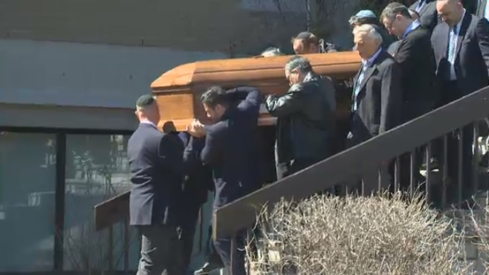 The coffin containing Mark Wainberg is taken out of Tiferette Beth David synagogue following funeral services on April 14, 2017