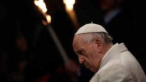 Pope Francis presides over the Via Crucis (Way of the Cross) torchlight procession on Good Friday in front of Rome's Colosseum. (AP Photo / Alessandra Tarantino)