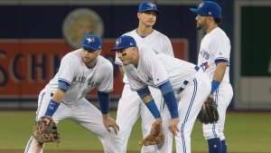 Toronto Blue Jays infielders Justin Smoak, left to right, Troy Tulowitzki, Darwin Barney and Devon Travis wait for a pitching change in the seventh inning of their AL baseball game against the Baltimore Orioles in Toronto on Friday April 14, 2017. (Fred Thornhill/The Canadian Press)