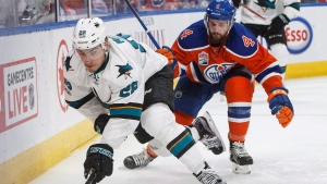San Jose Sharks' Timo Meier (28) and Edmonton Oilers' Kris Russell (4) battle for the puck during third period NHL playoff action in Edmonton, Alta., on Friday April 14, 2017. (Jason Franson / THE CANADIAN PRESS)