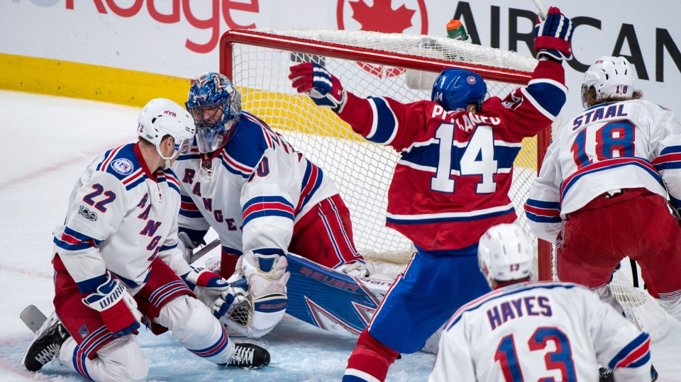 Montreal Canadiens' Tomas Plekanec celebrates his goal past New York Rangers goaltender Henrik Lundqvist as Rangers' defenseman Nick Holden (22) looks on during third-period Game 2 NHL Stanley Cup first-round playoff hockey game action Friday, April 14, 2017, in Montreal. (Paul Chiasson/The Canadian Press via AP)