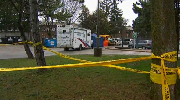 Police tape cordons off the area where a 24-year-old man's body was found in a parking lot on Chester Le Boulevard Saturday April 15, 2017.