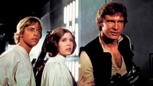 "This photo provided by Twentieth Century Fox Home Entertainment shows, Mark Hamill, from left, as Luke Skywalker, Carrie Fisher as Princess Leia Organa, and Harrison Ford as Hans Solo in the original 1977 ""Star Wars: Episode IV - A New Hope."" (Twentieth Century Fox Home Entertainment via AP)"