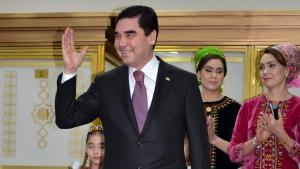 Turkmenistan President Gurbanguly Berdimuhamedov, center, greets journalists after casting his ballot at a polling station in Ashgabat, Turkmenistan, Sunday, Feb. 12, 2017. (Alexander Vershinin/AP Photo)