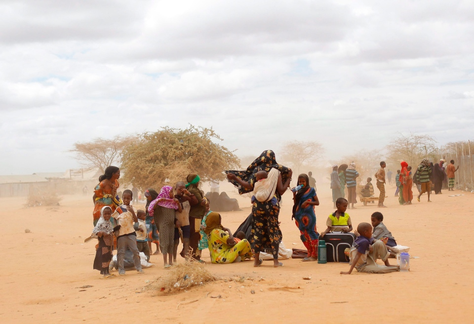 In this Friday, Aug. 5, 2011, file photo, newly arrived Somali refugees wait outside a UNHCR processing center at the Ifo refugee camp outside Dadaab, eastern Kenya, 100 kilometers from the Somali border. (Jerome Delay, File/AP Photo)