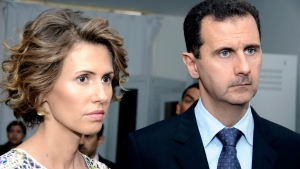 In this Tuesday, July 13, 2010 file photo, Syrian President Bashar Assad, right, and his wife Asma Assad, listen to explanations as they visit a technology plant in Tunis. (AP Photo/Hassene Dridi, File)